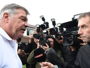 Sam Allardyce speaks to the press outside his home in Bolton