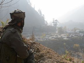 A file picture showing an Indian army soldier guarding a base at Uri
