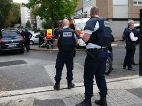 Police officers stand guard after the arrest of a man who opened fire on shoppers injuring two people before fleeing the scene outside a supermarket in Le Port-Marly, near Paris, on September 26, 2016. Police surrounded the home of the attacker, where he holed up after shooting a 57-year-old woman and a 73-year-old man in what prosecutors called a 'private dispute'. The shooter was already known to police for common law offences. / AFP / Thomas SAMSON