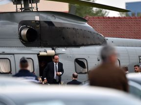 French President Francois Hollande get off an helicopter on September 26, 2016 to visit Calais, the northern French port which is home to the sprawling 'Jungle' migrant camp. President Francois Hollande will visit the notorious 'Jungle' camp near Calais, which he has vowed to close despite growing controversy over the fate of thousands of desperate migrants at the squalid settlement. He said during his visit that the migrant camp there must be 'completely dismantled'. He also called on Britain t