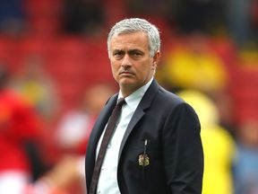 Jose Mourinho looks on prior to kick-off at Vicarage Road
