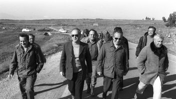 Israel's Prime Minister Yitzhak Rabin (2nd L), Defence Minister Shimon Peres and Security Advisor Ariel Sharon (R) walk together during a visit to an army base in the Golan Heights on December 11, 1975