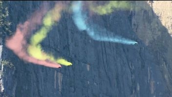 Competitors in the Wings for Love event in China leap off the mountains in Dashanbao, Yunnan, and race to the ground using wingsuits