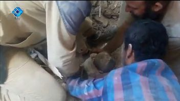 A toddler is rescued from rubble after a bombing in Aleppo