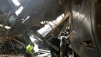 Train personel survey the NJ Transit train that crashed in to the platform at the Hoboken Terminal September 29, 2016 in Hoboken, New Jersey