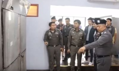 Thai police raid on suspected foreign forgery gang uncovers body in freezer