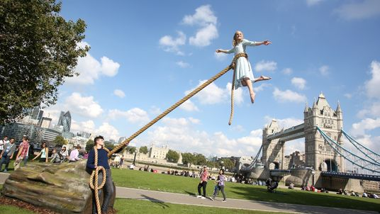 """Performers Sean Atkins and Sally Miller standing in for the characters played by Asa Butterfield and Ella Purnell during a photocall for Tim Burton's """"Miss Peregrines Home For Peculiar Children"""" at Potters Field Park, London"""