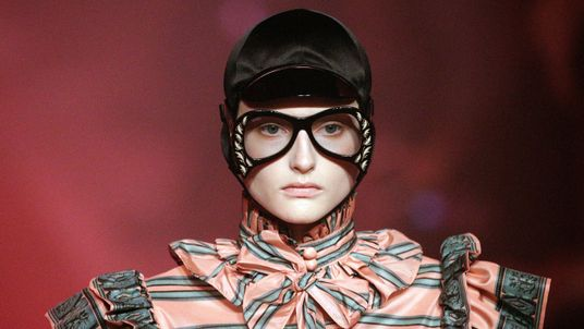 A model presents a creation at the Gucci fashion show