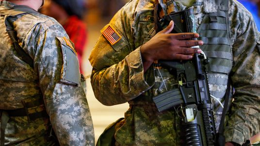 National Guard troops in the streets during another night of protests over the police shooting of Keith Scott in Charlotte, North Carolina
