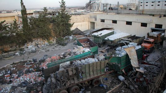 Aid is seen strewn across the groud in the town of Orum al-Kubra on the western outskirts of the northern Syrian city of Aleppo