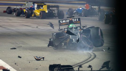 Force India's Nico Hulkenberg crashes during the F1 Singapore Grand Prix