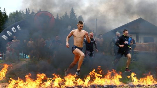 """Participants take part in an extreme run """"Bison race"""" near the town of Logoisk, Belarus"""