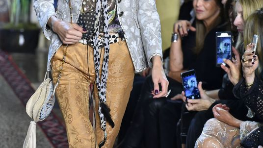 A model presents a creation for fashion house Roberto Cavalli