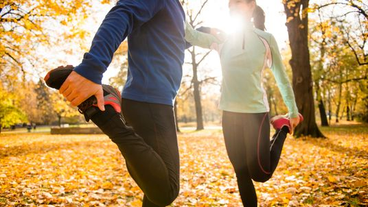 A couple exercising in the woods