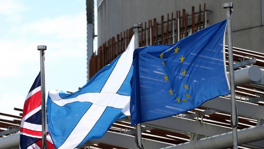 The Union Jack, Saltaire and EU flags fly outside the Scottish parliament buildings