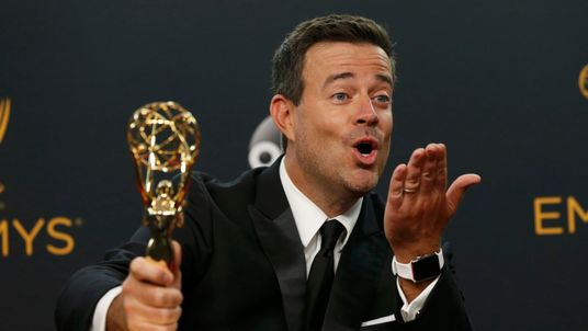 "Carson Daly poses backstage with his award for Outstanding Reality-Competition Program for ""The Voice"""
