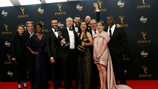 "The cast and crew of ""Veep"" pose backstage with their award for Outstanding Comedy Series"