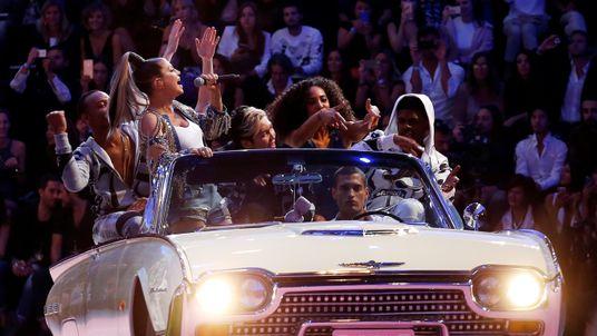 U.S. singer Fergie (2nd L) performs during the Philipp Plein fashion show