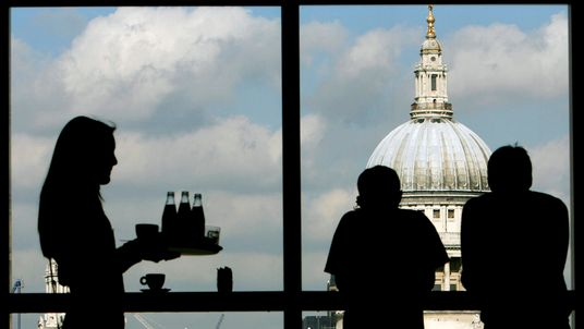 Visitors admire St Paul's Cathedral from the restaurant of the Tate Modern March 2007