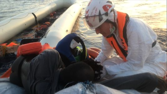 A medic treats one of the migrants