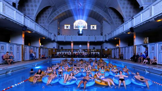 """People attend the screening of the film """"Jaws""""  screened at Strasbourg public baths during the European Fantastic Film Festival, in France"""