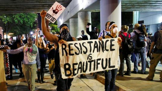 Demonstrators in the streets during another night of protests over the police shooting of Keith Scott in Charlotte, North Carolina