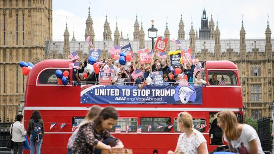 The 'Stop Trump' campaign bus travels around Parliament Square, urging American expats across the UK to register and vote in the US election in November