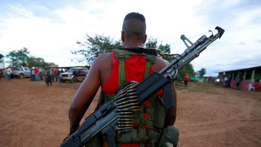 A fighter from Revolutionary Armed Forces of Colombia (FARC), arriving at the camp where they prepare for an upcoming congress ratifying a peace deal with the government, near El Diamante in Yari Plains, Colombia