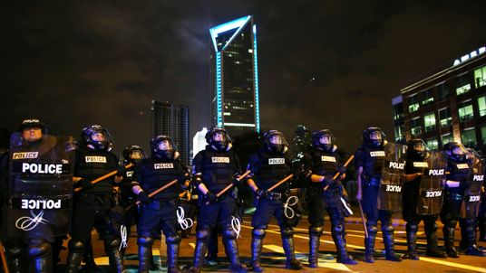 Police on the streets during another night of protests over the police shooting of Keith Scott in Charlotte, North Carolina