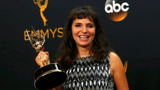 "Susanne Bier poses with her award for Outstanding Directing For A Limited Series, Movie Or Dramatic Special for ""The Night Manager"""