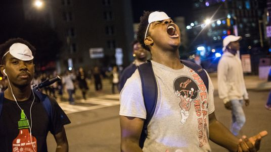 A demonstrator shouts during protests