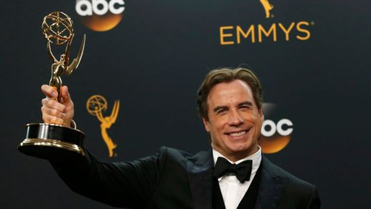 "Actor John Travolta poses backstage with the award for Outstanding Limited Series for FX Network's ""The People v. O.J. Simpson: American Crime Story"""
