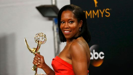 "Regina King poses backstage with her award for Outstanding Supporting Actress In A Limited Series Or Movie for ""American Crime"""