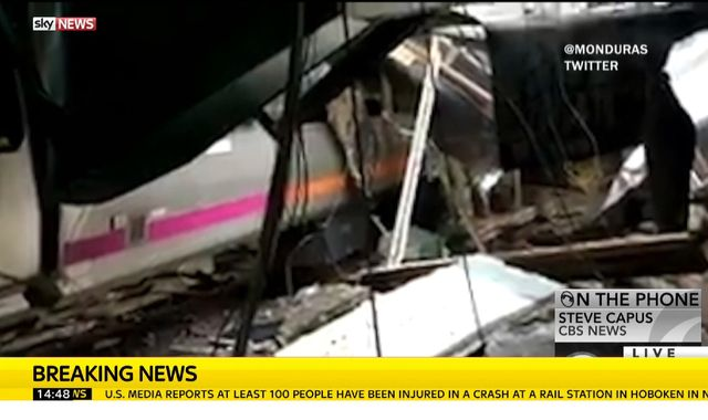 One dead and dozens injured after train crashes into New Jersey station