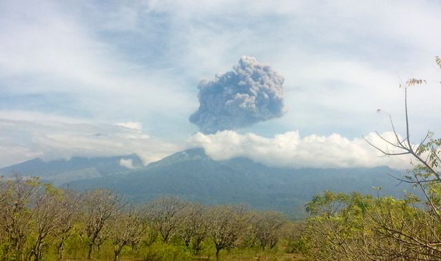 Hundreds of tourists missing after volcano erupts on Indonesian island