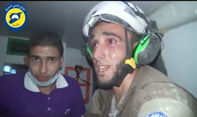 Rescue worker breaks down as baby is saved from rubble in Syria