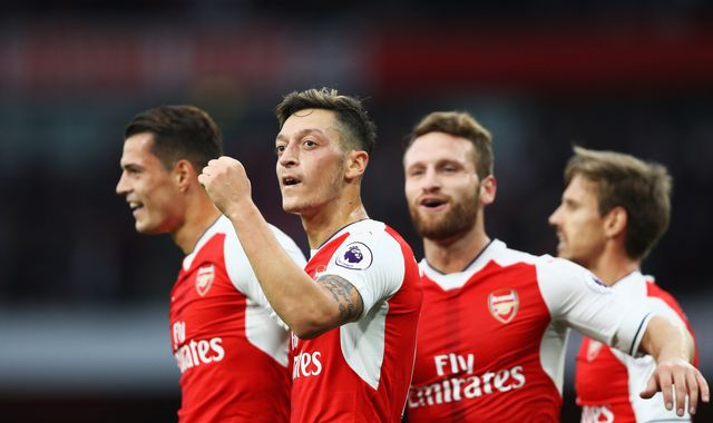 Wenger: players stay for trophies, not cash