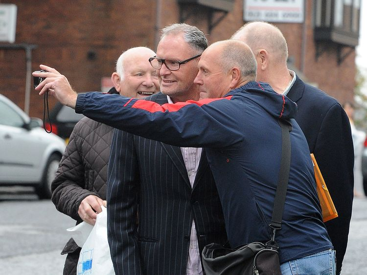 Fans take pictures with Paul Gascoigne as he makes his way into court
