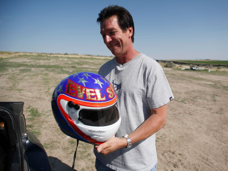 Eddie Braun holds his helmet before testing the rocket in 2014