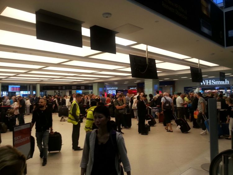 Passengers wait for information inside the terminal. Picture:Jody Pirrone