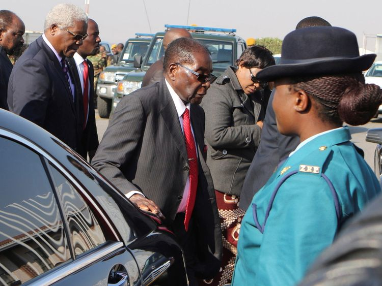 Zimbabwe's President Robert Mugabe arrives home at the airport in Harare