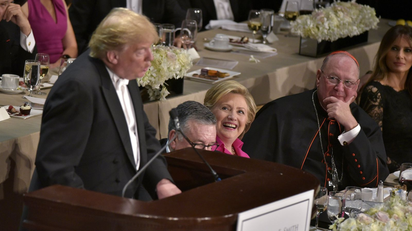 Democratic presidential nominee Hillary Clinton laughs as Republican presidential nominee Donald Trump speaks during the 71st annual Alfred E. Smith Memorial Foundation Dinner