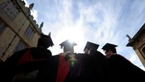 A group of Oxford University graduates celebrate
