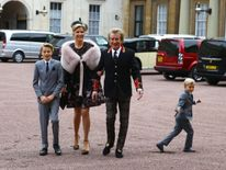 Veteran singer Sir Rod Stewart arriving at Buckingham Palace in London, with his wife, Penny Lancaster and children Alastair and Aiden, ahead of him receiving his knighthood in recognition of his services to music and charity