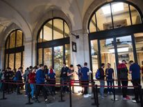 People queuing outside the Apple Store in London's Covent Garden last month to buy the new iPhone 7