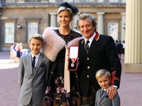 Veteran singer Sir Rod Stewart at Buckingham Palace in London, with his wife, Penny Lancaster and children Alastair and Aiden, after he received his knighthood in recognition of his services to music and charity