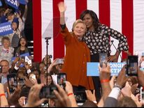 Michelle Obama on stage with Hillary Clinton