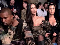 Kanye West at the Off-White show in Paris with wife Kim Kardashian