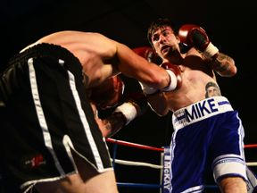 Mike Towell (R) taking on Danny Little during a fight in May last year