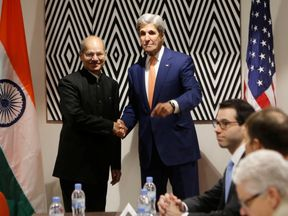 US Secretary of State John Kerry with India's minister of environment, forest and climate change Anil Madhav Dave before the agreement in Rwanda
